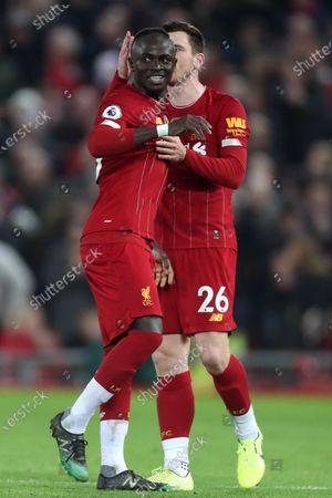 Sadio Mane of Liverpool celebrates scoring his sides first goal with Adam Lallana