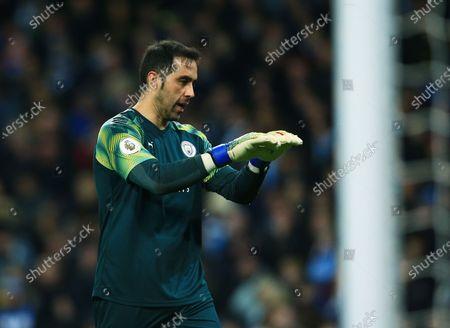 Manchester City goalkeeper Claudio Bravo gestures to dive