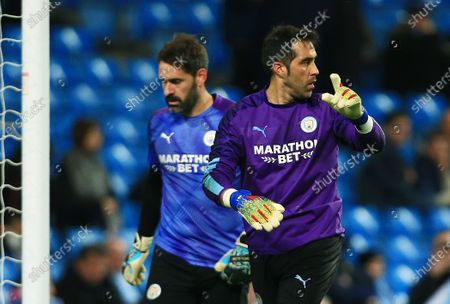 Manchester City goalkeeper Claudio Bravo warms up ahead of the game