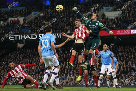 Manchester City goalkeeper Claudio Bravo punches the ball clear