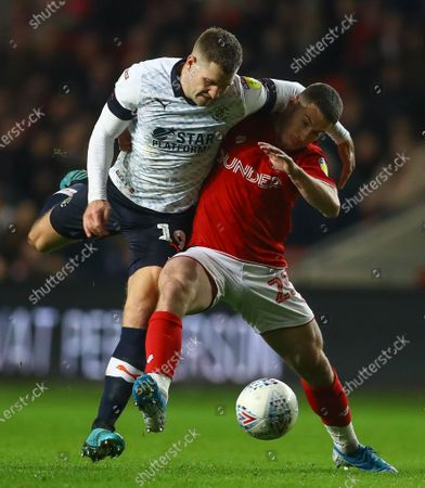 James Collins of Luton Town and Tommy Rowe of Bristol City in action
