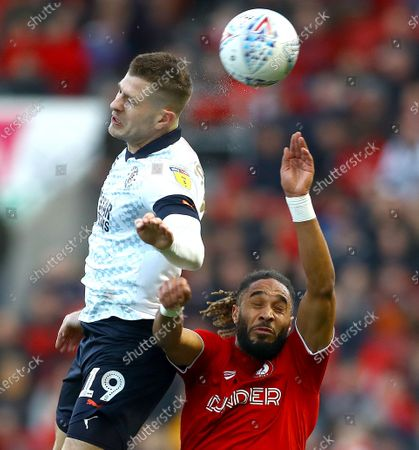 James Collins of Luton Town and Ashley Williams of Bristol City in action