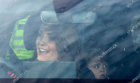 Catherine (L), the Duchess of Cambridge drives as her son Prince Louis (R) looks on as they arrive at Buckingham Palace for the traditional Queen's Christmas lunch in London, Britain, 18 December 2019.
