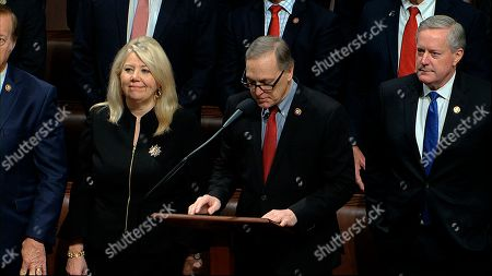 Stock Picture of Rep. Andy Biggs, R-Ariz., makes a motion for the House to adjourn as the House of Representatives debates the articles of impeachment against President Donald Trump at the Capitol in Washington, . At left is Rep. Debbie Lesko, R-Ariz., and at right is Rep. Mark Meadows, R-N.C