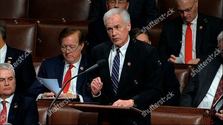 Stock Image of Rep. Tom McClintock, R-Calif., speaks as the House of Representatives debates the articles of impeachment against President Donald Trump at the Capitol in Washington