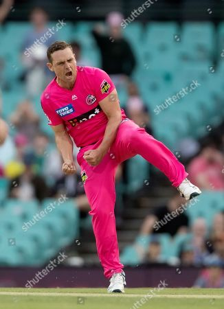Sydney Sixers player Stephen O'Keefe celebrates taking the wicket of Perth Scorchers player Cameron Bancroft