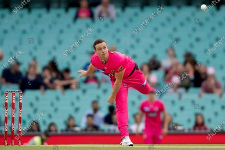 Sydney Sixers player Stephen O'Keefe bowls to take the wicket of Perth Scorchers player Cameron Bancroft