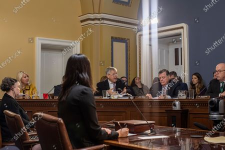 United States Representative Rob Woodall (Republican of Georgia), left, argues with the chair about the impeachment during a US House Committee on Rules hearing to consider H. Res. 755 'Impeaching Trump, President of the United States, for high crimes and misdemeanors'. Pictured from left to right: US Representative Debbie Lesko (Republican of Arizona), Rep. Woodall, US Representative Tom Cole (Republican of Oklahoma), Ranking Member, US House Committee on Rules and US Representative Jim McGovern (Democrat of Massachusetts), Chairman, US House Committee on Rules.