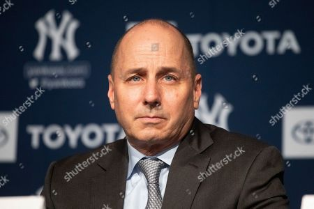 Yankees general manager Brian Cashman listens as Gerrit Cole is introduced as the newest New York Yankees player during a baseball media availability, in New York. The pitcher agreed to a 9-year $324 million contract