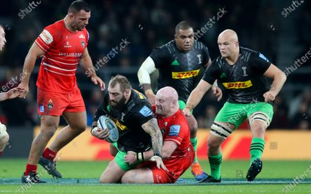 Joe Marler of Harlequins tackled by England team mate Dan Cole of Leicester Tigers