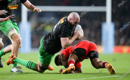 Matt Symons of Harlequins tackled by Kyle Eastmond of Leicester Tigers