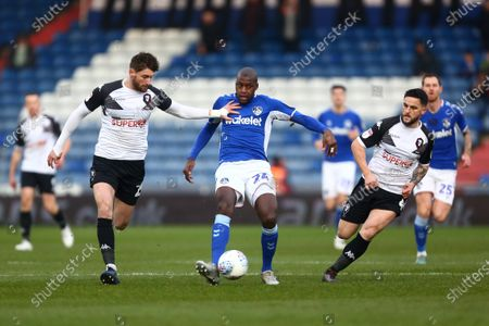 Joey Jones of Salford City and Oldham's Mohamed Sylla