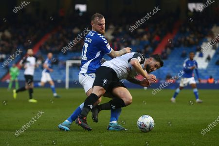 Oldham's David Wheater tackles Craig Conway of Salford City