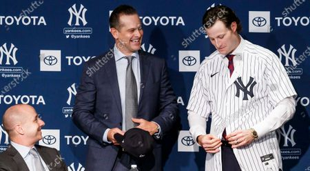 Baseball player Gerrit Cole (R) stands with Yankees manager Aaron Boone as Yankees general manager Brian Cashman (L) looks on during a press conference introducing Cole as the newest member of the New York Yankees at Yankees Stadium in the Bronx, New York, USA, 18 December 2019. Cole, a pitcher who was with the Houston Astros, joins the Yankees with a nine-year contract worth $324 million/€291 million contract, which is the largest ever contract for a pitcher in baseball.