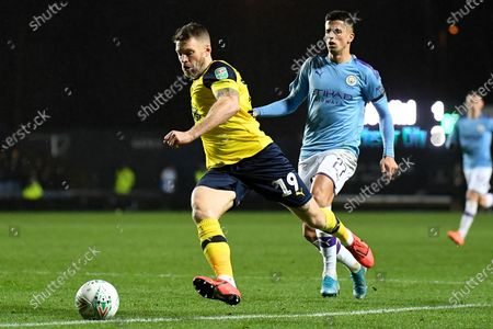 Oxford United forward Jamie Mackie (19) sprints forward with the ball during the EFL Cup match between Oxford United and Manchester City at the Kassam Stadium, Oxford