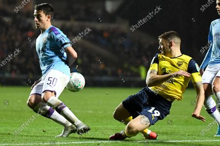 Oxford United forward Jamie Mackie (19) see his cross charged down by Manchester City defender Eric Garcia (50) during the EFL Cup match between Oxford United and Manchester City at the Kassam Stadium, Oxford