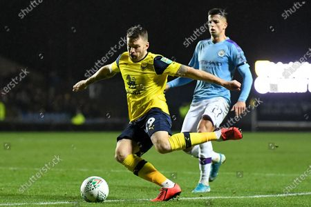 Oxford United forward Jamie Mackie (19) looks to cross during the EFL Cup match between Oxford United and Manchester City at the Kassam Stadium, Oxford