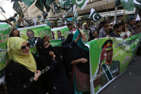 Supporters of former Pakistani military ruler Gen. Pervez Musharraf protest a court's decision, in Karachi, Pakistan, . The Pakistani court sentenced Musharraf to death in a treason case related to the state of emergency he imposed in 2007 while in power, officials said. Musharraf who is apparently sick and receiving treatment in Dubai where he lives was not present in the courtroom