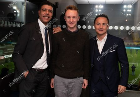 Stock Photo of Chris Kamara and Dennis Wise pose with fans before the match