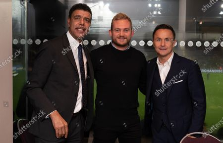Chris Kamara and Dennis Wise pose with fans before the match