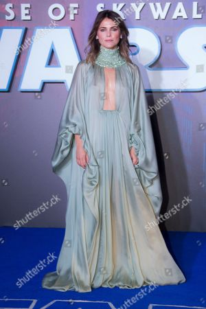 Keri Russell pose for photographers upon arrival at the premiere for the film 'Star Wars: The Rise of Skywalker', in central London