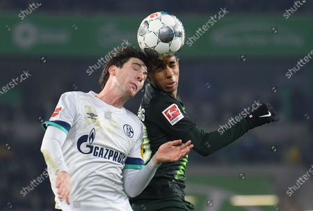 Juan Miranda of Schalke (L) in action against Joao Victor of Wolfsburg  during the German Bundesliga soccer match between VfL Wolfsburg and FC Schalke 04 in Wolfsburg, Germany, 18 December 2019.