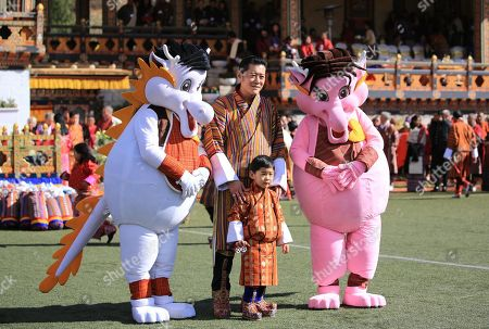 Stock Image of His Majesty The King Jigme Khesar Namgyel Wangchuck and His Royal Highness The Gyalsey with the mascots.