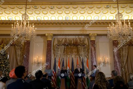 Secretary of State Mike Pompeo, second from right, and Secretary of Defense Mark Esper, right, accompanied by Indian External Affairs Minister Dr. S. Jaishankar, second from left, and Defense Minister Shri Rajnath Singh, left, during a news conference after a bilateral meeting at the Department of State in Washington, Wednesday, Dec.18, 2019