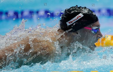 Shows United States' Caeleb Dressel swimming in the men's 100m butterfly final at the World Swimming Championships in Gwangju, South Korea. In the post-Michael Phelps world, Dressel fits snugly into the successor's slot. Coming off two dynamic performances at the world swimming championships, Dressel figures to be one of the biggest stars at the 2020 Tokyo Games. Yet he is reticent to step into the spotlight