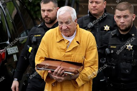 From shows former Penn State University assistant football coach Jerry Sandusky, center, as he arrives at the Centre County Courthouse for resentencing on his 45-count child sexual abuse conviction. Sandusky's bid for a reduced prison term was thwarted after a judge gave him the same sentence, 30 to 60 years, that was imposed in the wake of his original 2012 conviction. An appeals court had ordered a new hearing for him