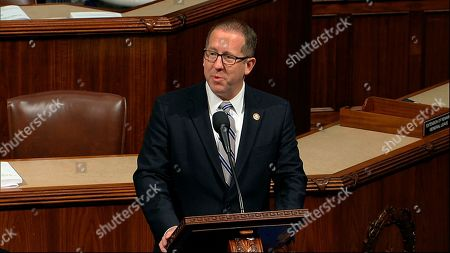 Stock Photo of Rep. Adrian Smith, R-Neb., speaks on the House floor as the House of Representatives debates the articles of impeachment against President Donald Trump at the Capitol in Washington