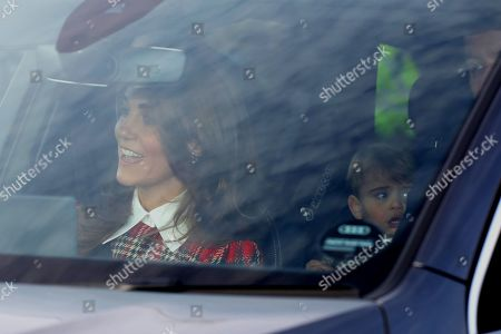 Catherine Duchess of Cambridge, driving, with Prince Louis behind, were amongst the guests as members of the Royal family attend The Queen's annual Christmas lunch.