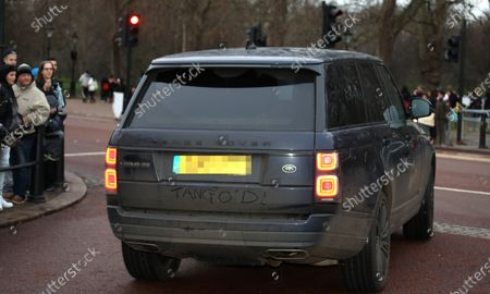 Somebody has written 'TANGO'D' in the dirt on the Land Rover driven by Lady Helen Taylor, husband Timothy and daughter Estelle, who were amongst the guest leaving the party as members of the Royal family attend The Queen's annual Christmas lunch.