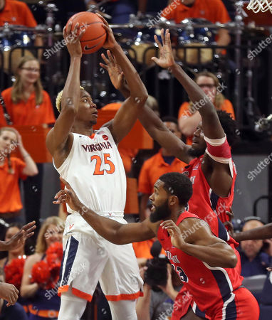 Virginia forward Mamadi Diakite (25) works next to Stony Brook guard Andrew Garcia (23) and center Jeff Otchere (4) during an NCAA college basketball game in Charlottesville, Va