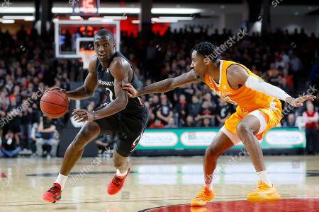 Keith Williams, Jordan Bowden. Cincinnati's Keith Williams (2) drives against Tennessee's Jordan Bowden (23) during the first half of an NCAA college basketball game, in Cincinnati