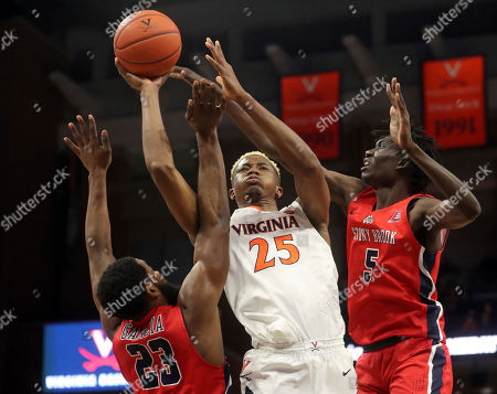Virginia forward Mamadi Diakite (25) shoots between Stony Brook guard Andrew Garcia (23) and forward Mouhamadou Gueye (5) during an NCAA college basketball game in Charlottesville, Va., . Virginia won 56-44