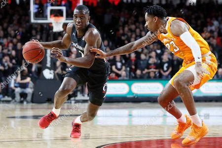 Keith Williams, Jordan Bowden. Cincinnati's Keith Williams, left, drives against Tennessee's Jordan Bowden (23) during the first half of an NCAA college basketball game, in Cincinnati