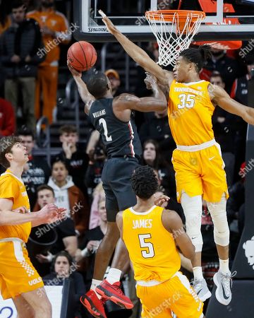 Keith Williams, Yves Pons. Cincinnati's Keith Williams (2) shoots against Tennessee's Yves Pons (35) during the first half of an NCAA college basketball game, in Cincinnati