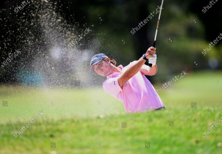 Smylie Kaufman of the USA plays a shot out of the bunker on day one of the 2019 Australian PGA Championship at RACV Royal Pines Resort on the Gold Coast, Australia, 19 December 2019.