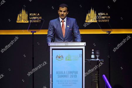 Emir of Qatar Sheikh Tamim bin Hamad Al Thani delivers a speech at the Kuala Lumpur Summit in Kuala Lumpur, Malaysia, . Malaysian Prime Minister Mahathir Mohamad said Wednesday an Islamic conference that includes leaders from Iran, Turkey and Qatar is aimed at tackling Islamophobia and finding solutions to challenges facing the Muslim world
