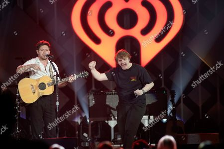Stock Photo of Niall Horan, Lewis Capaldi. Niall Horan, left, and Lewis Capaldi performs during 103.5 KISS FM's Jingle Ball at the Allstate Arena, in Rosemont, Ill