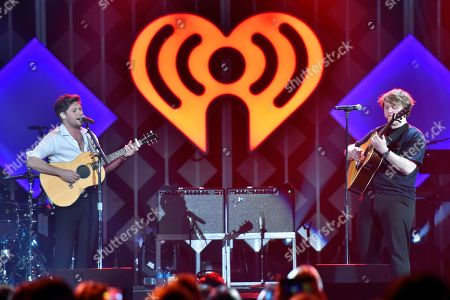 Niall Horan, Lewis Capaldi. Niall Horan, left, and Lewis Capaldi performs during 103.5 KISS FM's Jingle Ball at the Allstate Arena, in Rosemont, Ill