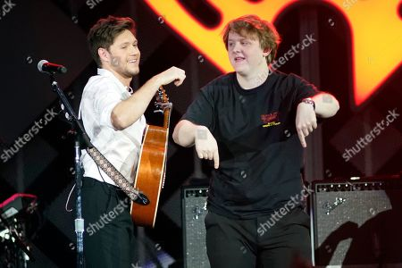 Stock Image of Niall Horan, Lewis Capaldi. Niall Horan, left, and Lewis Capaldi perform during 103.5 KISS FM's Jingle Ball at the Allstate Arena, in Rosemont, Ill