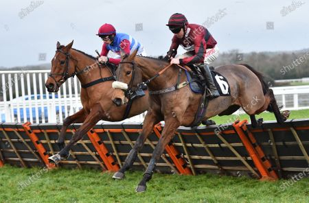 (L) The Worlds End (Adrian Heskin) takes the last on the first circuit before going on to win The Marsh (The Long Walk) Hurdle Race from (R) Papagana (Leighton Aspell).