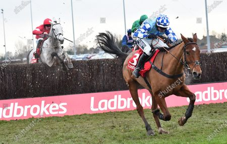 Bun Doran (Jonathan Burke) takes the last before going on to win The Ladbrokes Desert Orchid Steeple Chase from (L) Duc Des Genievres (James Bowen).