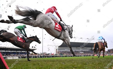 (R) Bun Doran (Jonathan Burke) takes the last before going on to win The Ladbrokes Desert Orchid Steeple Chase from (C-No 2) Duc Des Genievres (James Bowen).