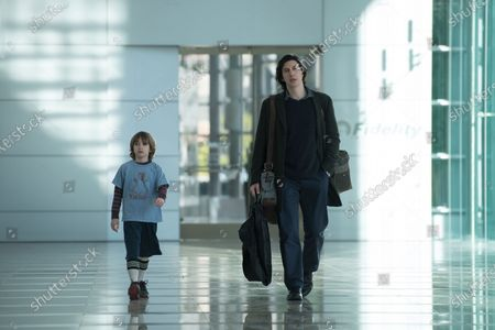 Stock Image of Azhy Robertson as Henry Barber and Adam Driver as Charlie