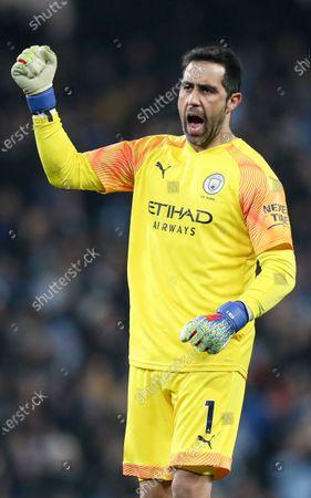 Stock Photo of Claudio Bravo of Manchester City celebrates the 1st goal scored by Gabriel Jesus