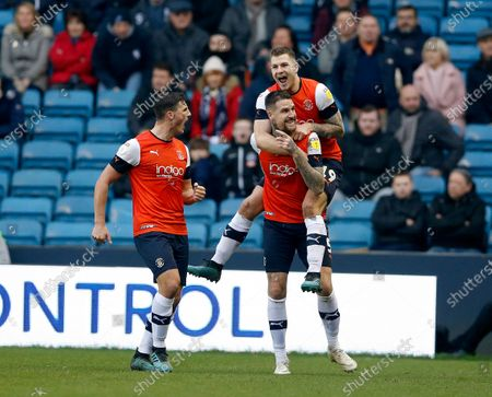 Sonny Bradley celebrates scoring the opening goal of the game for Luton Town with James Collins and Matty Pearson