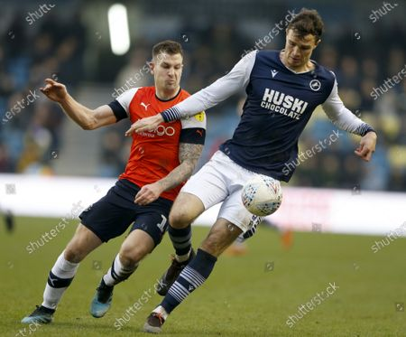 Jake Cooper of Millwall and James Collins of Luton Town compete for the ball